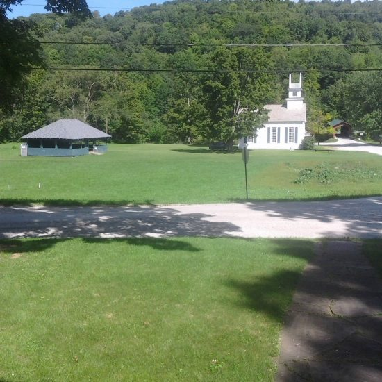 From inside their home, the Rockwells had a view of the dance pavilion, 1802 church, and the covered bridge on the Village Green.