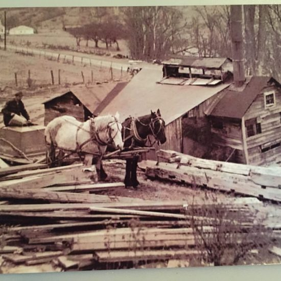 Farmers in West Arlington enjoyed field-raised meats, garden vegetables, and a beautiful landscape along the Batten Kill river, but generally didn't have a lot of cash. Credit cards had not been invented yet and bank loans were not so easy to get. If you had an old sap house like the Edgerton family, patching it up with old boards kept it going. Norman's son Tommy, who lived next door, liked to help make syrup with the Edgerton family, which modeled for many paintings. Courtesy of Ardis Edgerton Clark.